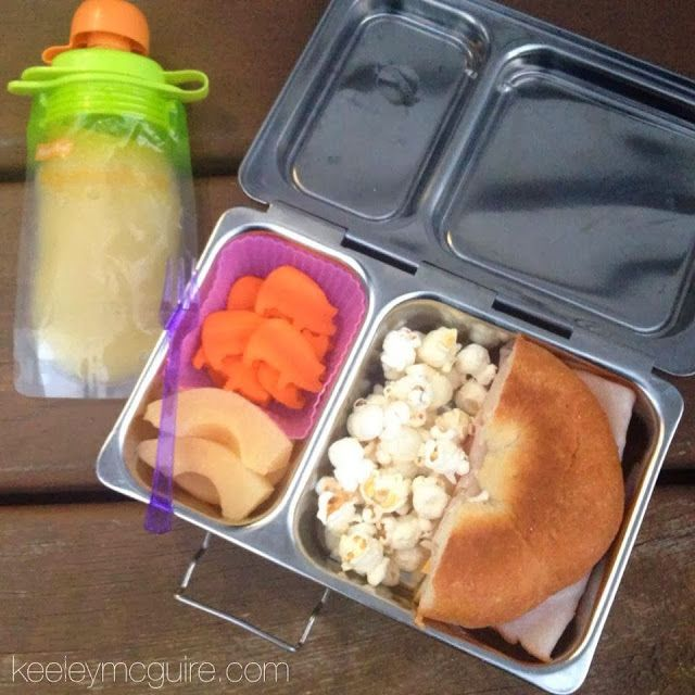 Udi's gluten, dairy, nut & soy free bagel sandwich, popcorn, pears, carrots cut out with our piggy shaped veggie cutter, and applesauce packed in a reusable pouch.