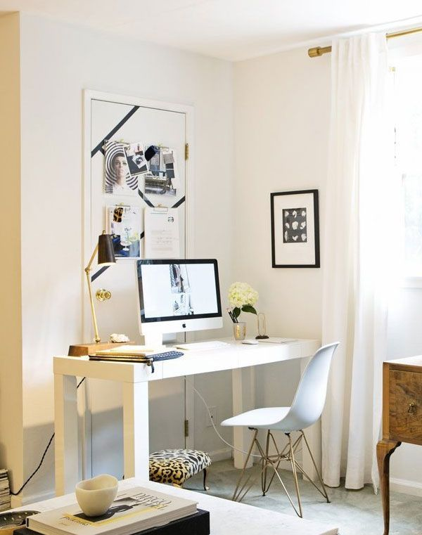 create a focal point over an awkward door: paint stripes over top, place desk in front