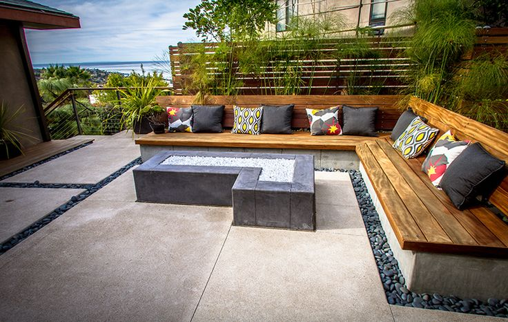 A Modern Concrete Hardscape With Mexican Beach Pebble