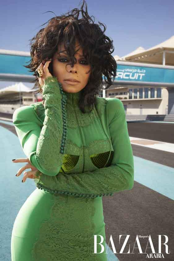 Janet Jackson....love the whole look. Hair, makeup, and the green