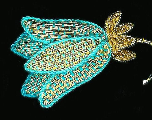 'Goldwork or Gold Embroidery is a 3-dimensional form of hand embroidery which involves sewing down felt or string as padding and then applying gold threads over the top.