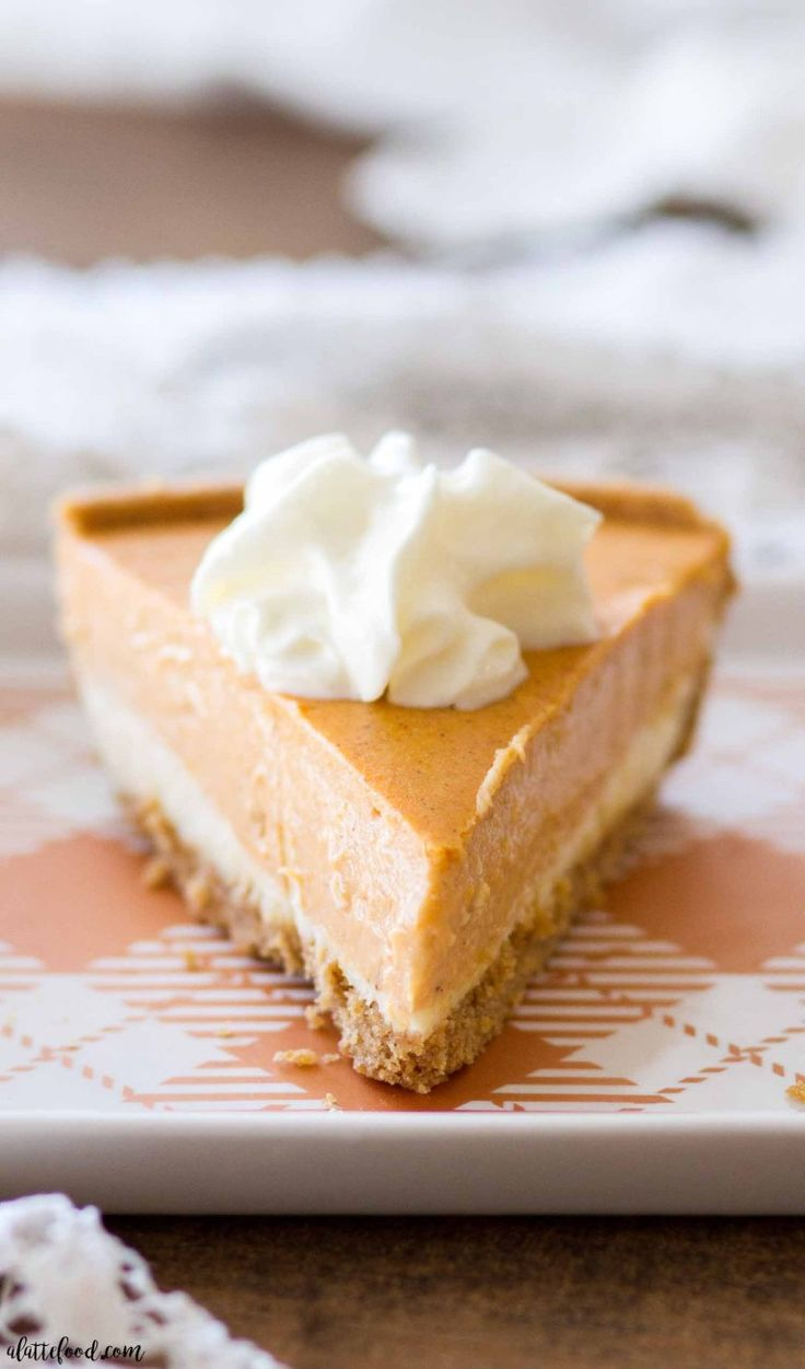 This homemade Pumpkin Cheesecake Recipe is gluten-free! A layer of vanilla chees…