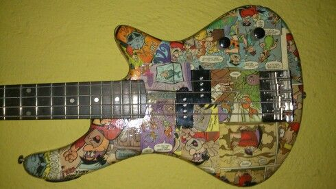 Custom made bass guitar Flintstones by Nic. Made on order by email