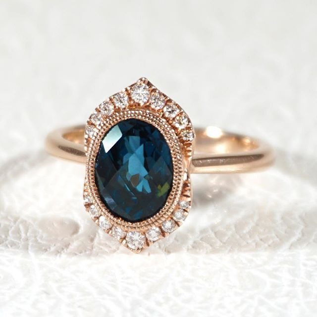 This shade of topaz is called London blue, and we love it with the rose gold and diamond halo! JosephJewelry.com   Designed and created by Joseph Jewelry   Seattle, WA   Bellevue, WA   Online   Design Your Own Engagement Ring   #engagementring