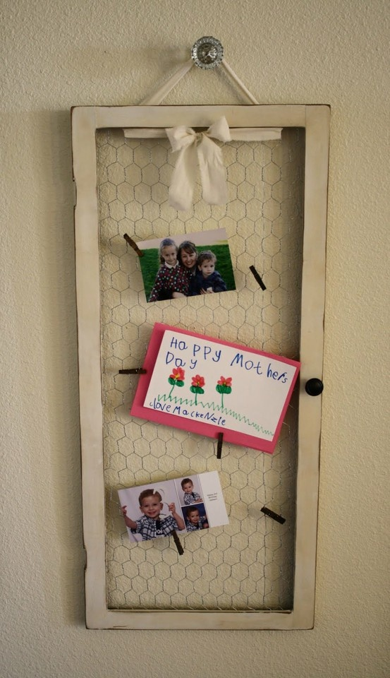 Well isn't this a cool idea! Chicken wire, ribbon, mini clothespins, and the frame of an old cabinet door.