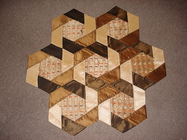 Quilt table toper, in larger size hexi block for a quilt would be pretty.