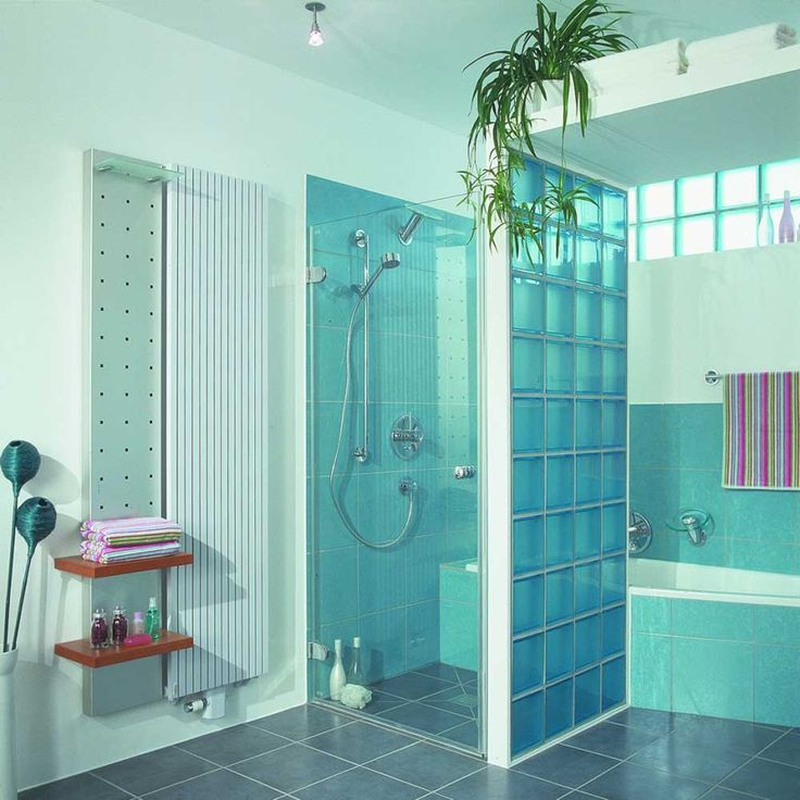Bathroom Blue Wall Tile Designs Ideas with chrome shower head and rectangular soaking bathtub