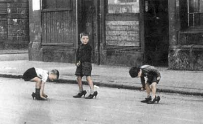 """Gorbals Boys""- three young boys playing in the street in their mother's high heels."