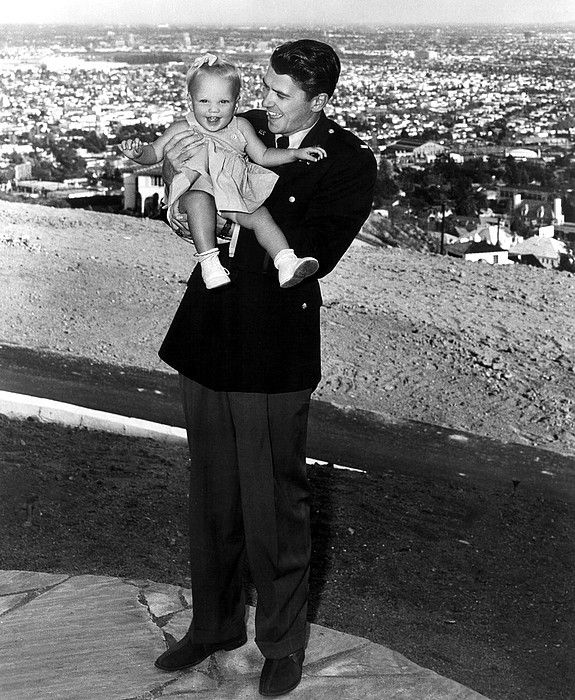 Ronald Reagan holding Maureen Reagan, 1943
