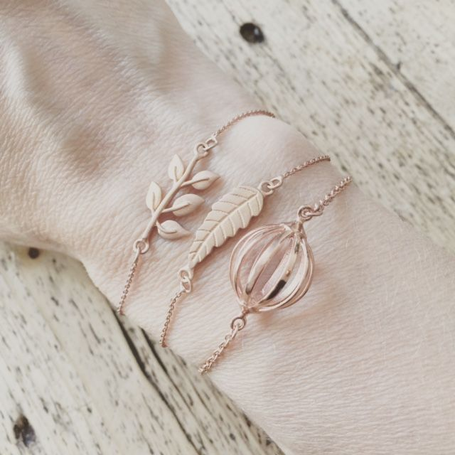 Grow, Feather and Belle Cage bracelets in rose gold plating.    Cahana is about welcoming warm and positive energy in your life.  Cahana Jewelry is designed to hold your affirmation, but also to support your wishes with precious and beautiful tokens and crystals, each carrying a special value and force.