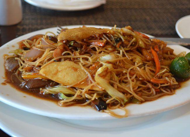 Pancit Bihon Guisado - Top 10 Filipino Food - or our full top 10 Filipino food check here: http://live-less-ordinary.com/eating-asia/top-10-filipino-food-pinoy-food