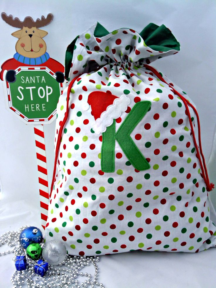 These gorgeous PERSONALISED Christmas Sacks are sure to bring squeals of delight from your child this Christmas. Made from Cotton fabric, fully lined for extra strength and durability it is sure to hold those special gifts. It features a double drawstring closure, felt initial and co-ordinating santa hat. A perfect gift that will be treasured for years to come. 55cm wide x 75cm tall (up to drawstring closure)