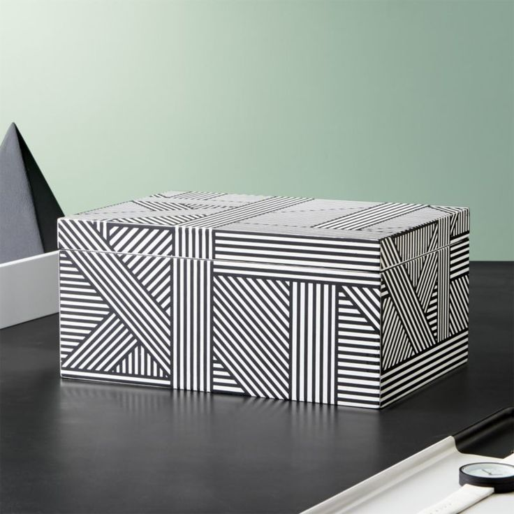 Shop Clasp Black and White Jewelry Box. Headquartered on a sailboat in San Francisco, Namavari Designs turns out innovative surface designs for everything from housewares to fashion to this chic black and white jewelry box.