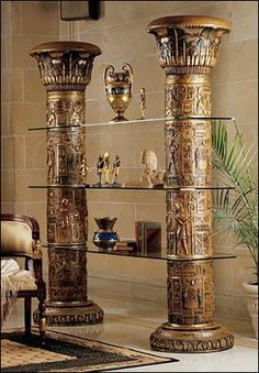 Rising like the famed Egyptian columns for which it is named, our seven-foot-tall work of furniture art is intricately carved and crowned with lotus leaf ...