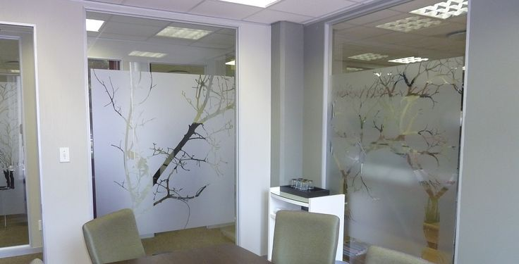 Frosted glass art transforms this office into a beautiful workplace