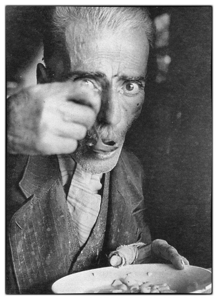 """""""Αποστείλατε σίτον ή φέρετρα"""". A Greek man at a soup kitchen in Athens 1941-42. It is estimated that at least 100.000 people died (up to 1000 a day) during the Athens famine, the three years of the Nazi occupation."""