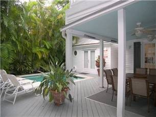 Lovely interior spaces to the tropical gardens, pool, and spa!    http://www.hotelsvshomes.com/holiday-rental-in-Key%20West-pid=HVH1264103