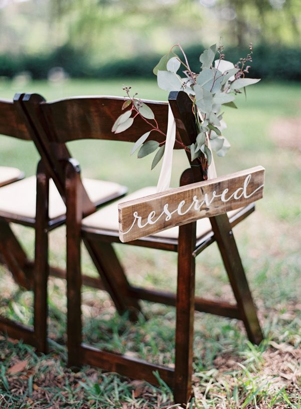 wedding chair decoration ideas with wooden reserved sign