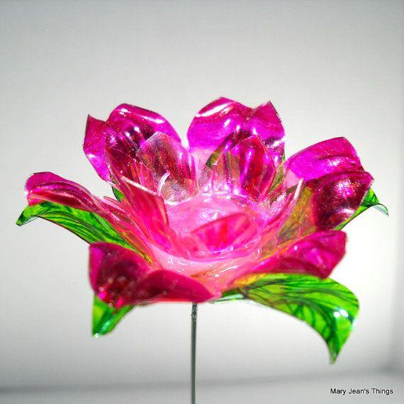 Best 25 plastic water bottles ideas on pinterest empty for Flowers in glass bottles