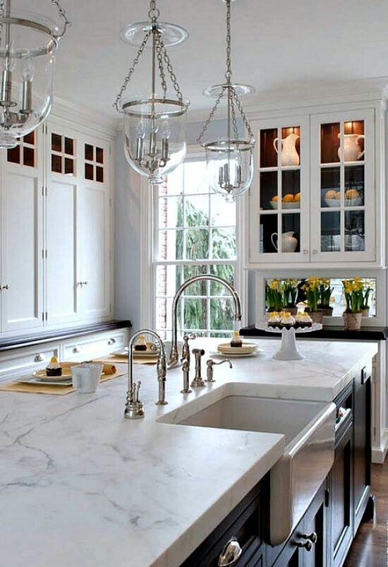 White kitchen with marble look counter