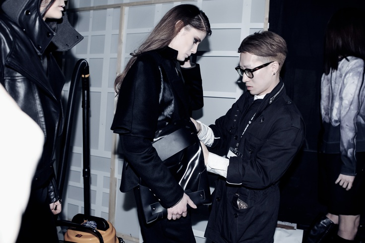 CRES. E DIM. model backstage of the FW13 collection show
