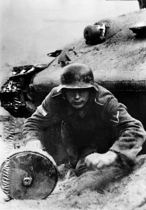 """panzerknacker88: """"German soldier pops out from a destroyed T-34 armed with an antitank Teller mine. On his right sleeve the Tank Destruction Badge (German: Sonderabzeichen für das Niederkämpfen von..."""