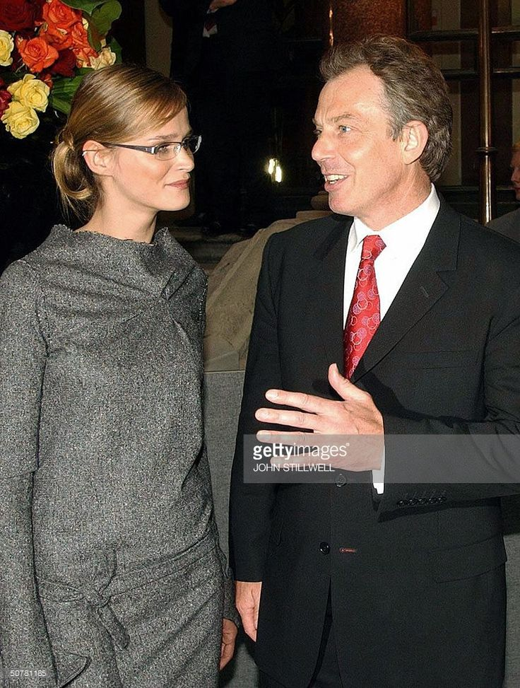 British Prime Minister Tony Blair (R) talks to Estonian supermodel Carmen Kass during the EU enlargement: Unification of Europe - VIP Party, to celebrate the entry of 10 new countries into the European Union, at the Foreign and Commonwealth Office in London 28 April 2004. AFP PHOTO/Photo John Stillwell