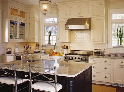 Cabinets from the woodharbor line with an antique white for White enamel kitchen cabinets