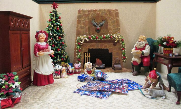 Meanwhile, back at the North Pole, Santa is checking his lists, the elves are feverishly wrapping gifts while the cat plays with the ribbon and Mrs. Claus brings snacks from the kitchen.