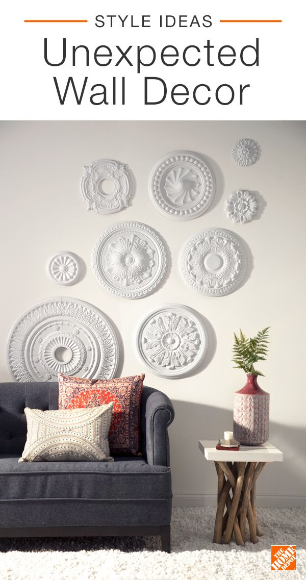 Create unexpected and interesting wall decor with ceiling medallions. A white-on-white gallery wall is minimal yet modern when paired with Swedish-farmhouse furniture and subtle pops of color. Try using this decor hack in your home to create an eye-catching monochromatic look. Click to explore the space.
