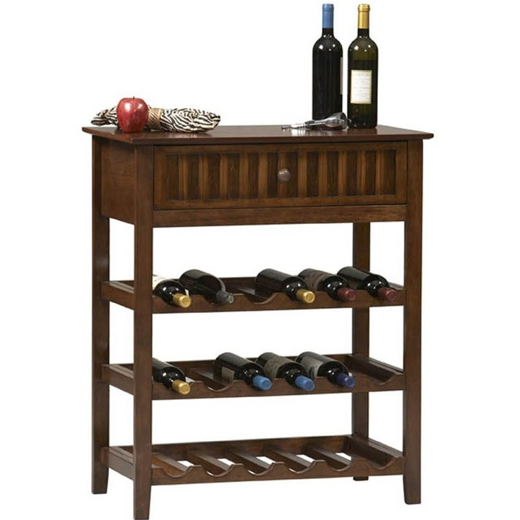 DSHD - Tasman Collection Wine Rack in Walnut Finish  The Tasman collection is a blend of the tropics and plantation style decor. This collection combines classic lines with casual materials to create a look that is reminiscent of travel to warm tropical climates. Each occasional piece features richly colored wood trim surrounding bamboo accents creating a rustic but elegant look. This wine rack features 1 drawer and 3 wine storage shelves which will hold up to 18 wine bottles.