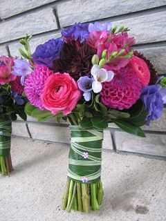 Pink and Purple Bridal Bouquet - pink ranunculus, alstromeria, and dahlias with burgundy dahlias, lavender freesia, and purple lisianthus. http://www.weddingflowerbuzz.com/pink-flowers-for-weddings.html#pink-flowers-for-weddings