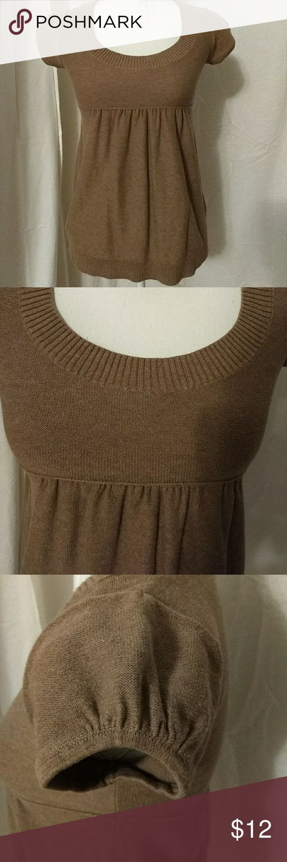 """Like New Scoop Neck Empire Waist Sweater Tunic Worn Once. Tan/Light brown sweater tunic with ribbed trim at neckline and hem. Slight ruching at top of sleeves, under bust and in middle of back. 100% Cotton. Length: 24.5"""" Bust: 28"""" Bottom Hem Opening: 38"""" Old Navy Tops"""