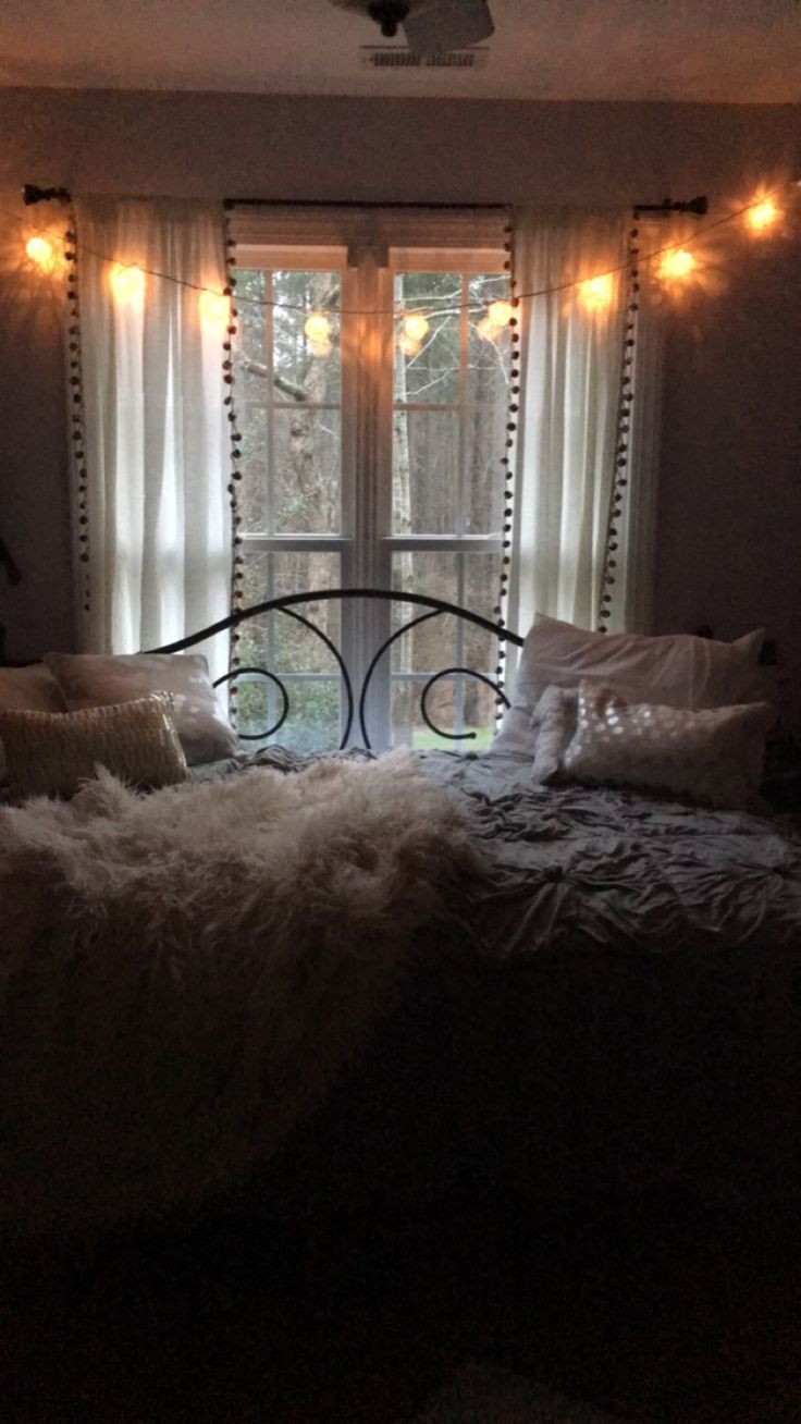 My Bedroom! Bed from Wayfair: Andover Mills scroll iron daybed full  Magical thinking Pom Poms curtains from urban outfitters  Grey Jersey Quilt from Tj max  Blanket from west elm  Pillows from target, pb teen, and home goods  Lighted lanterns from ac moore