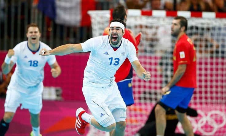 France's Nikola Karabatic (center) celebrates winning the men's handball quarterfinals match against Spain on Aug. 8. (Marko Djurica/Reuters) #