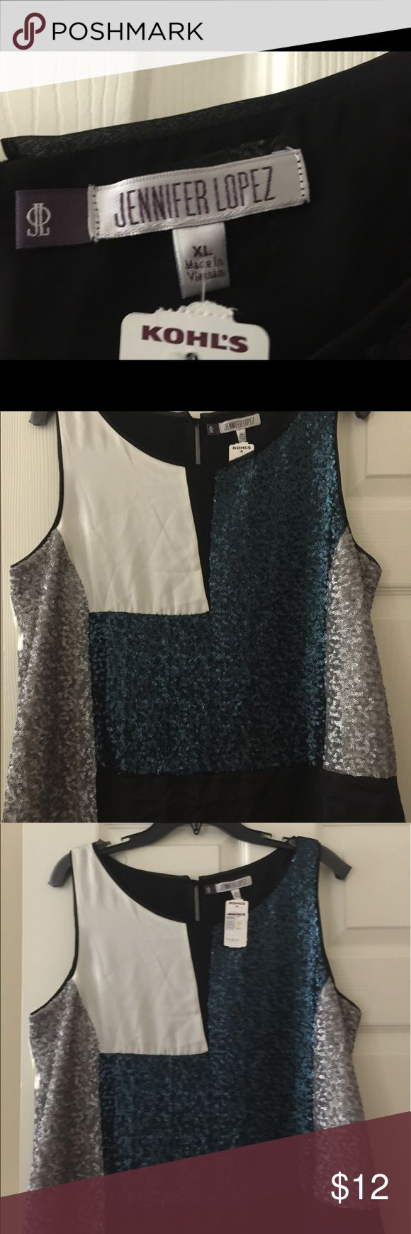 NWT Jennifer Lopez XL Sequined Dress Top NWT Jennifer Lopez XL Dress top.  Stunning short sleeve dressy JLO top.  Gorgeous top. Regret that I never had a place to wear this.  No weight loss equals your gain.  With this purchase I will include a thank you note and gift!  You will love this top! Jennifer Lopez Tops