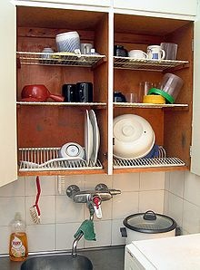 Every Finnish home has a...dish draining cupboard above the sink.