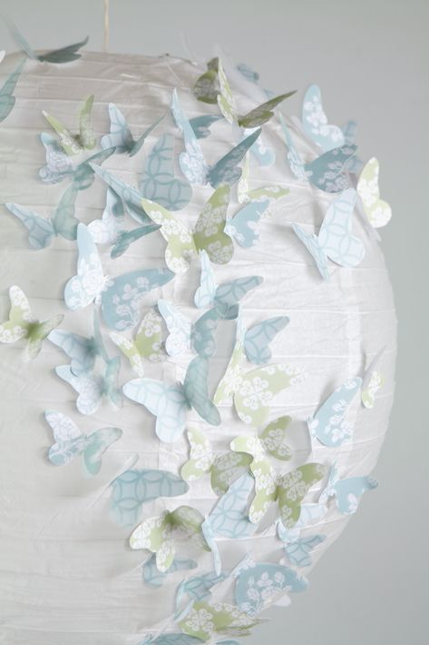 Butterfly lampshade~~~You will need  • paper lantern  • paper with butterfly outlines  • butterfly templates (below)  • scissors  • glue gun