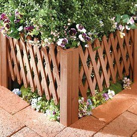 "Garden Creations Extendable Garden Edging (2 Pack) by Jobar. $9.99. Lining a walk or drive, neatening up a flowerbed - there are dozens of places you'll use the accordion- style extendable edging throughout your garden. Wood edging E-X-P-A-N-D-S for a custom fit. Solid wood weathers beautifully, adusting from 8¾"" to 36"" w x 13"" h.. Garden Creations Extendable Garden Edging (2 Pack)  Wood edging E-X-P-A-N-D-S for a custom fit.   Lining a walk or drive, neatening up a flowerb..."