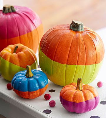 Dunk miniature pumpkins in bright hues for a modern autumnal display.                 What You'll Need                 Skewers, shoebox, miniature pumpkins, latex paint, bucket, painter's tape (optional)                 Make It                 1. Poke four skewers through shoebox to create a place to dry pumpkins. 2. Pour paint into a bucket that's wider than largest pumpkin. 3. Dip pumpkin in either straight down or at an angle and let excess drip off the bottom into bucket. 4. Rest…