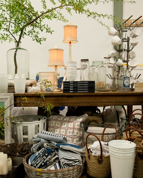 this is my idea of a great flea market display....love to poke around at outdoor markets and antique stores.