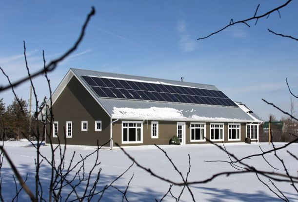 South side of the house showing solar panel array. The panels feed energy into the grid as part of Ontario' microFit program.  Passive Solar Design | Sustainable Building | Solares Architecture