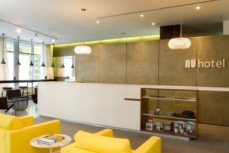Modern hotel lobby newmodern chic front desk lobby for Small hotel interior design