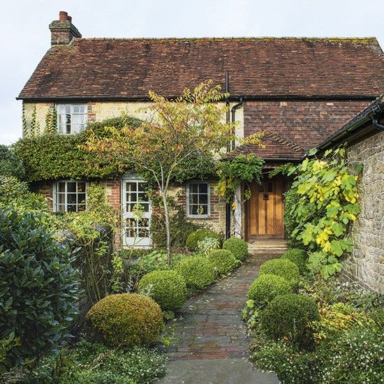 This Grade II chocolate box cottage in West Sussex was bought by the owners in order to give their children the rural upbringing they both experienced