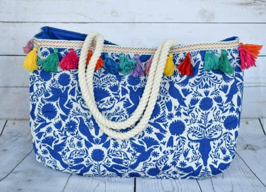 JUDITH MARCH BLUE BIRD JACQUARD TOTE WITH MULTI TASSEL TRIM $64.00 USD shopdejavu.com