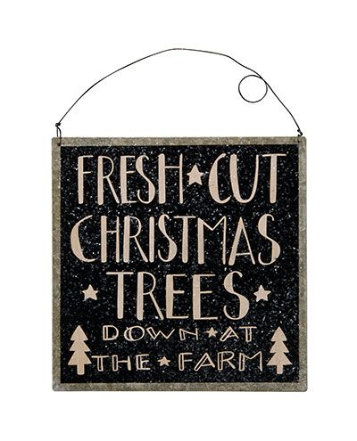 Christmas Trees Tin Sign, by Primitives by Kathy. Galvanized tin sign painted black, featuring a hand-lettering-style font in black, distressed for a rustic look, and lightly dusted with mica glitter. This one reads: Fresh cut Christmas trees down at the farm. Measures 7 x 7 inches. Other metal signs and ornaments also available!