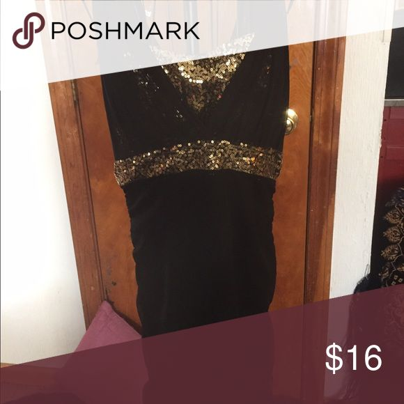 Little black dress with a shiny twist! The accentuated little black dress that sparkles! Attached gold sequin bandeau top with a glamorous sweet heart neckline. An absolute head turner! Like new condition. Never worn. Dresses Midi