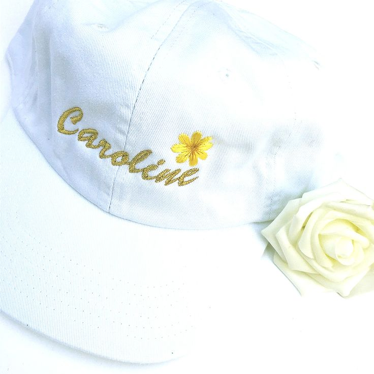 CAROLINE IS NOW PRETTY AS A FLWR 🌼  (Custom Hat— Font: Dear Diary, Thread colors: Metallic Gold, Yellow, Tan Placement Size: Medium) / Stitch Bitch online custom embroidery for denim jackets, dad caps, and tops! Custom embroidered clothing makes the perfect unique gift for women!