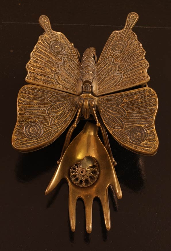 Gorgeous door knocker from Brook and Lyn blog.