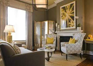 Chic gray livingroom with yellow and taupe accents. Like the chair print.